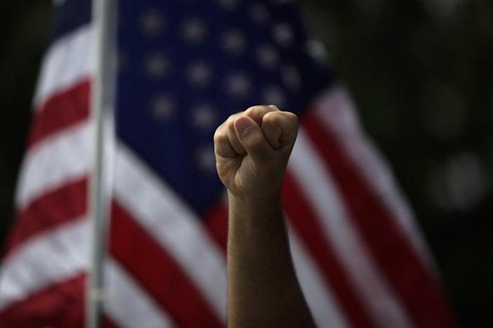 A demonstrator raises his fist during a protest over the death of George Floyd, in Anaheim, Calif. (AP Photo/Jae C. Hong, File)