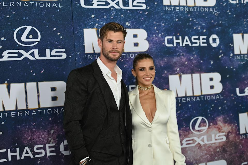 """Australian actor Chris Hemsworth and his wife Spanish model Elsa Pataky attend the """"Men In Black: International"""" premiere in New York City. (Credit: ANGELA WEISS/AFP/Getty Images)"""