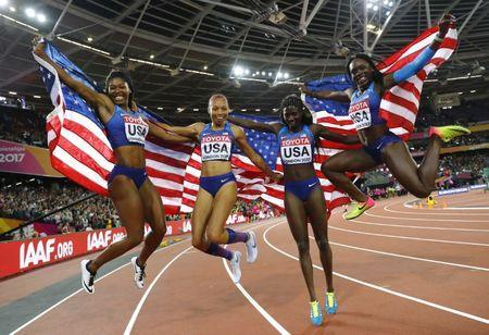 Athletics - World Athletics Championships - Women's 400 Metres Relay Final - London Stadium, London, Britain – August 12, 2017. Aaliyah Brown, Allyson Felix, Morolake Akinosun and Torie Bowie of the U.S. celebrate winning the final. REUTERS/Kai Pfaffenbach