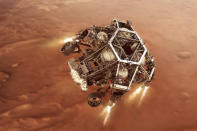 """In this illustration provided by NASA, the Perseverance rover fires up its descent stage engines as it nears the Martian surface.. This phase of its entry, descent and landing sequence, or EDL, is known as """"powered descent."""" (NASA/JPL-Caltech via AP)"""