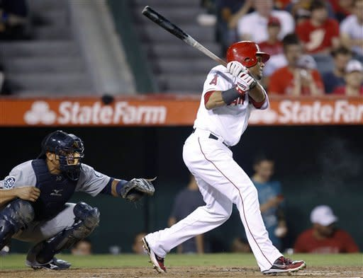 Los Angeles Angels' Erick Aybar watches his two-run double during the second inning of a baseball game against the Seattle Mariners in Anaheim, Calif., Wednesday, Sept. 26, 2012. (AP Photo/Jae C. Hong)