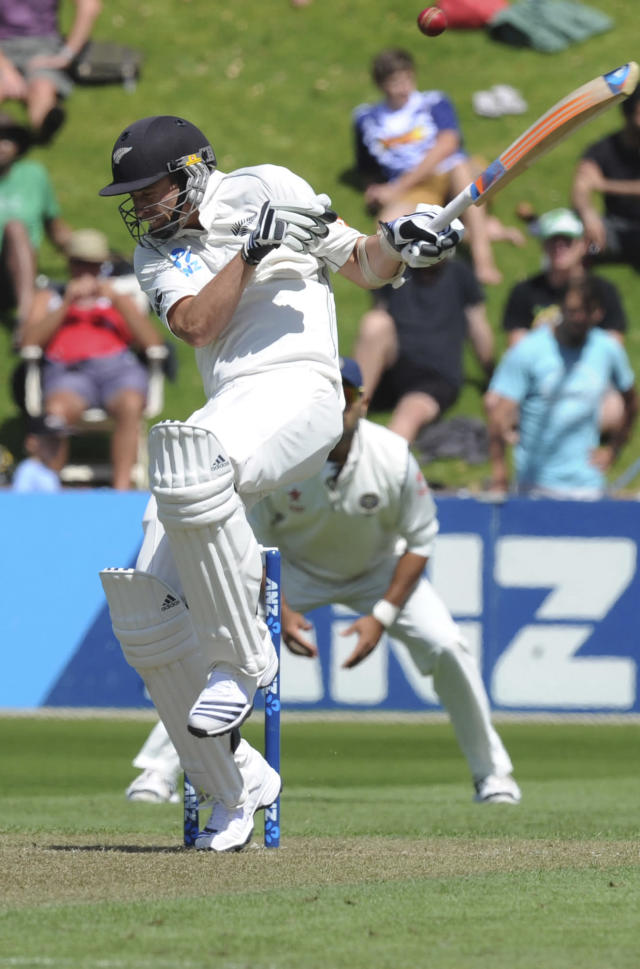 New Zealand's Tim Southee ducks a ball against India on the 1st day of the 2nd cricket test at Basin Reserve in Wellington, New Zealand, Friday, Feb. 14, 2014. (AP Photo/SNPA, Ross Setford) NEW ZEALAND OUT