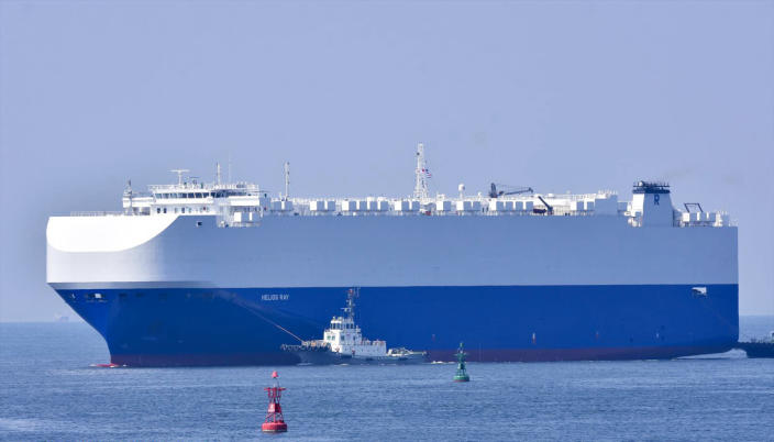 In this Aug. 14, 2020, photo, the vehicle cargo ship Helios Ray is seen at the Port of Chiba in Chiba, Japan. An explosion struck the Israeli-owned Helios Ray as it sailed out of the Middle East on Friday, Feb. 26, 2021, an unexplained blast renewing concerns about ship security in the region amid escalating tensions between the U.S. and Iran. (Katsumi Yamamoto via AP)