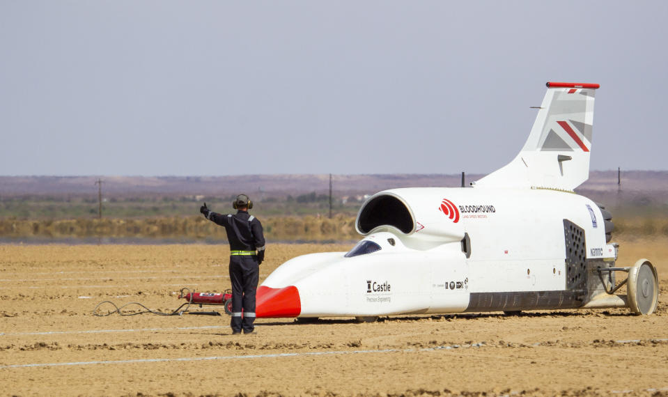 In this handout photo provided by Bloodhound, the vehicle is set for a trail run along the Hakskeenpan track in South Africa during trials to set a land speed record Friday, Nov. 8, 2019. Hitting 501 miles per hour on the South Africa's northern desert, the Bloodhound became one of the world's 10 fastest cars this week, on target for its goal to set a new land speed record. A jet that stays on earth, Bloodhound's next goal is to reach 550 miles per hour, possibly in the coming week. (Charlie Sperring/Bloodhound via AP)