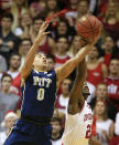 Pittsburgh's James Robinson (0) and Indiana guard Stanford Robinson (22) battle for a rebound during the first half of an NCAA college basketball game Tuesday, Dec. 2, 2014, in Bloomington, Ind. (AP Photo/Darron Cummings)