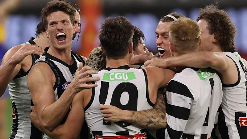Collingwood players are pictured celebrating after defeating West Coast in the AFL finals.