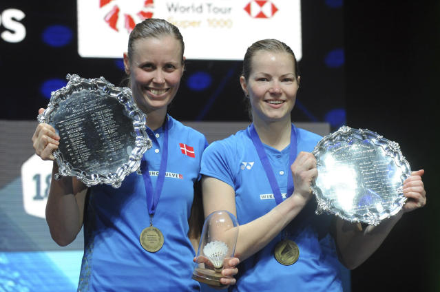 Denmark's Kamilla Rytter Juhl and Christinna Padersen, right, pose with their trophies after defeating Japan's Yuki Fukushima and Sayaka Hirota in the women's doubles final match at the All England Open Badminton tournament in Birmingham, England, Sunday March 18, 2018. (AP Photo/Rui Vieira)
