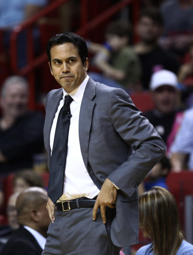 Miami Heat coach Erik Spoelstra watches game action against the San Antonio Spurs during the first half of a NBA basketball game in Miami, Sunday, Jan. 26, 2014. (AP Photo/J Pat Carter)