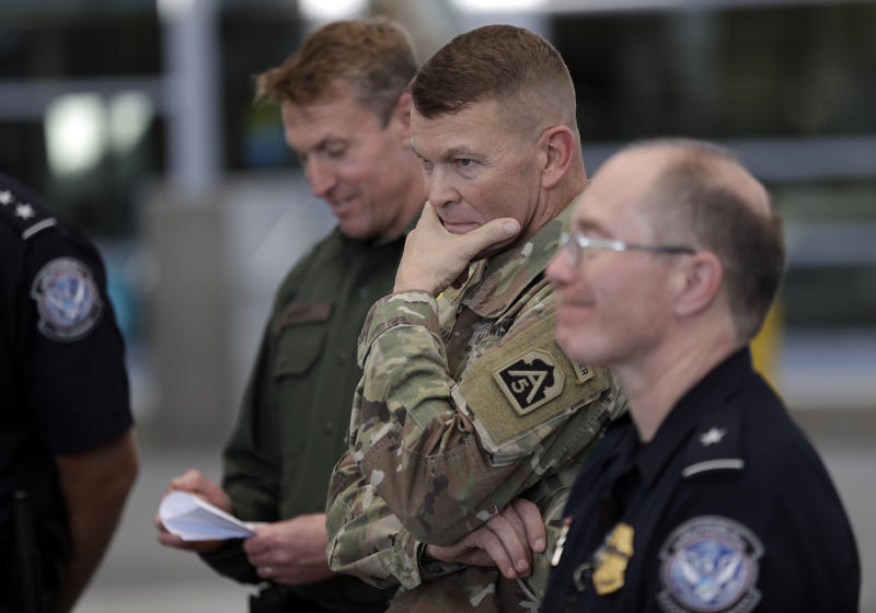 U.S. Army Lt. General Jeffrey Buchanan, center, looks on during a tour of the San Ysidro Port of Entry Friday, Nov. 9, 2018, in San Diego. The military is expected to have the vast majority of the more than 7,000 troops planned for the mission along the border deployed by Monday, and that number could grow. (AP Photo/Gregory Bull)