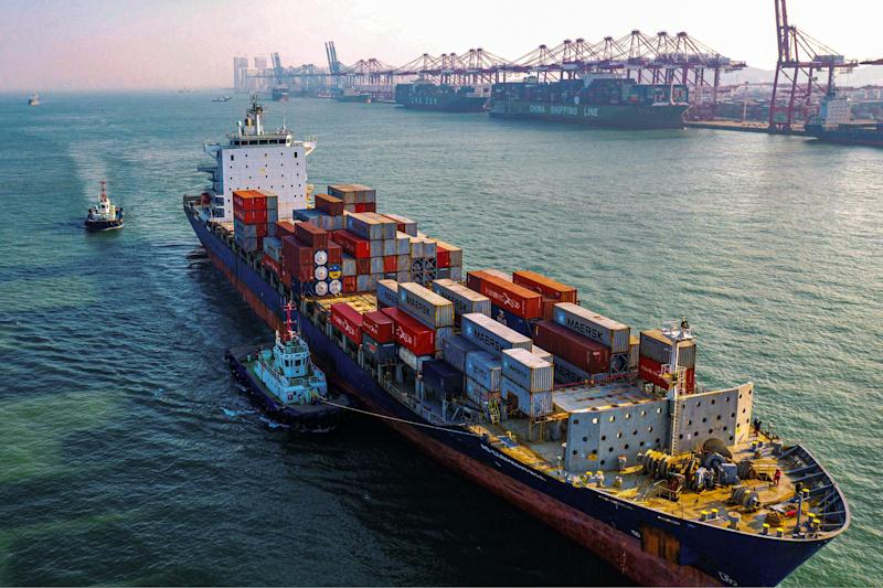 A cargo ship loaded with containers makes its way at a port in Qingdao in China's eastern Shandong province on January 14, 2020. - China's trade surplus with the United States narrowed last year as the world's two biggest economies exchanged punitive tariffs in a bruising trade war, official data showed on January 14, on the eve of a deal to ease tensions. (Photo by STR / AFP) (Photo by STR/AFP via Getty Images)