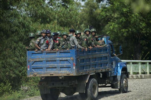 PHOTO: Armed military troops and police officers travel in trucks through Maungdaw, Myanmar, Oct. 14, 2016. (Ye Aung Thu/AFP/Getty Images)