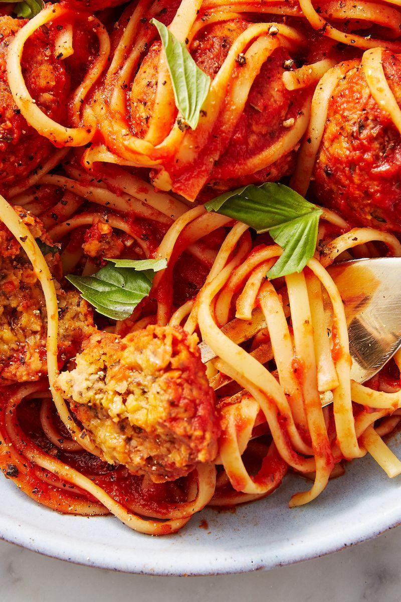 """<p>Few comfort foods satisfy like a hearty bowl of <a href=""""https://www.delish.com/uk/cooking/recipes/a28868982/best-spaghetti-and-meatballs-recipe/"""" rel=""""nofollow noopener"""" target=""""_blank"""" data-ylk=""""slk:spaghetti and meatballs"""" class=""""link rapid-noclick-resp"""">spaghetti and meatballs</a>. Now, my vegan friends, you TOO can enjoy this comfort sans guilt! These chickpea based meatballs pack tons of flavour, come together quickly, and even provide a good amount of protein and fibre. </p><p>Get the <a href=""""https://www.delish.com/uk/cooking/recipes/a29844763/vegan-meatballs-recipe/"""" rel=""""nofollow noopener"""" target=""""_blank"""" data-ylk=""""slk:Best-Ever Vegan Meatballs"""" class=""""link rapid-noclick-resp"""">Best-Ever Vegan Meatballs</a> recipe.</p>"""