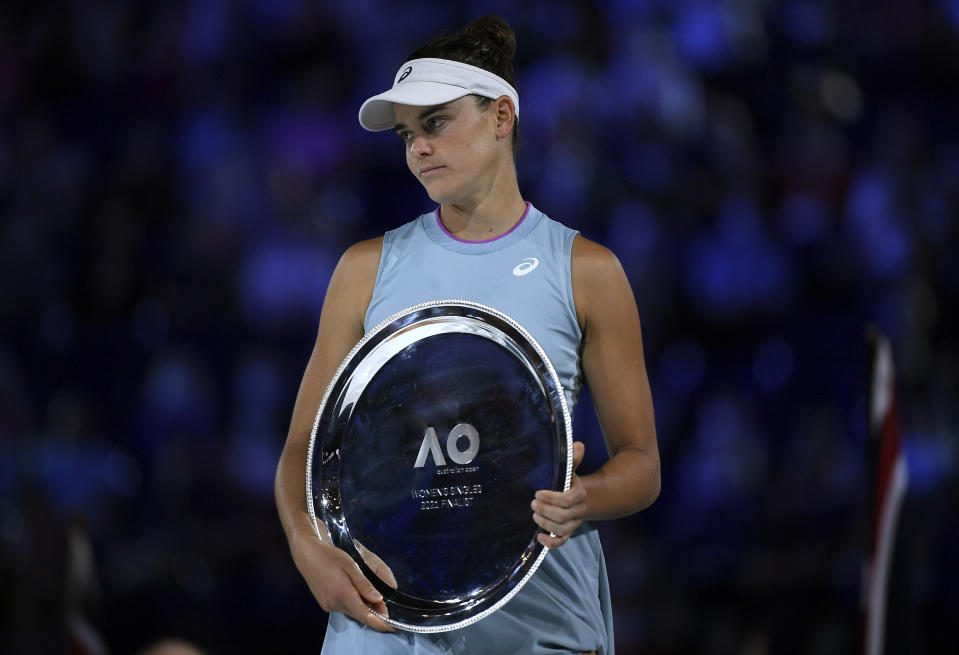 United States' Jennifer Brady holds her runners-up trophy after she lost to Japan's Naomi Osaka in the women's singles final at the Australian Open tennis championship in Melbourne, Australia, Saturday, Feb. 20, 2021.(AP Photo/Andy Brownbill)