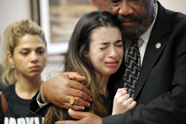 <p>Aria Siccone, 14, a 9th grade student survivor from Marjory Stoneman Douglas High School, where more than a dozen students and faculty were killed in a mass shooting on Wednesday, cries as she recounts her story from that day, while state Rep. Barrinton Russell, D-Dist. 95, comforts her, as they talk to legislators at the state Capitol regarding gun control legislation, in Tallahassee, Fla., Wednesday, Feb. 21, 2018. (Photo: Gerald Herbert/AP) </p>