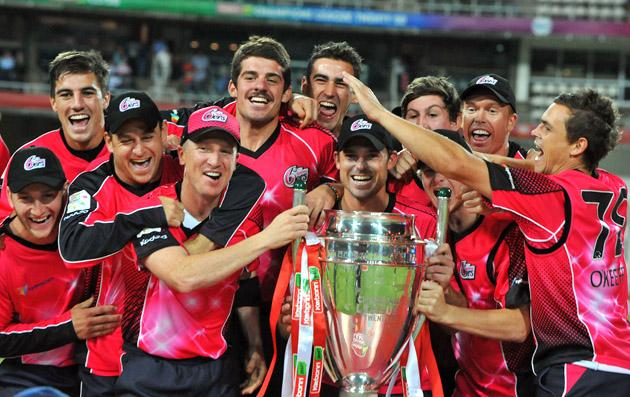 The Sydney Sixers celebrate with the trophy after winning the Karbonn Smart CLT20 Final match between bizhub Highveld Lions and Sydney Sixers at Bidvest Wanderers Stadium on October 28, 2012 in Johannesburg, South Africa. (Photo by Duif du Toit/Gallo Images/Getty Images)