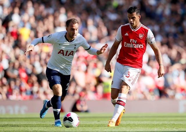 Christian Eriksen, left, scored the opening goal for Tottenham in the 2-2 draw with Arsenal. (Reuters)