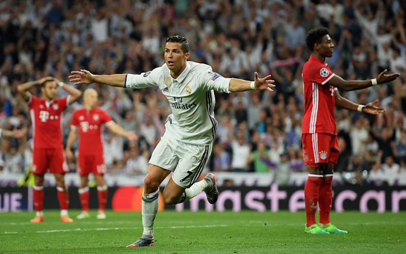 Cristiano Ronaldo of Real Madrid celebrates scoring his sides second goal during the UEFA Champions League Quarter Final second leg match - Credit: Getty Images
