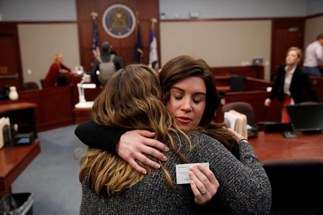 Larissa Boyce, right, gets a hug from Alexis Alvarado, both victims of Larry Nassar. (Getty)