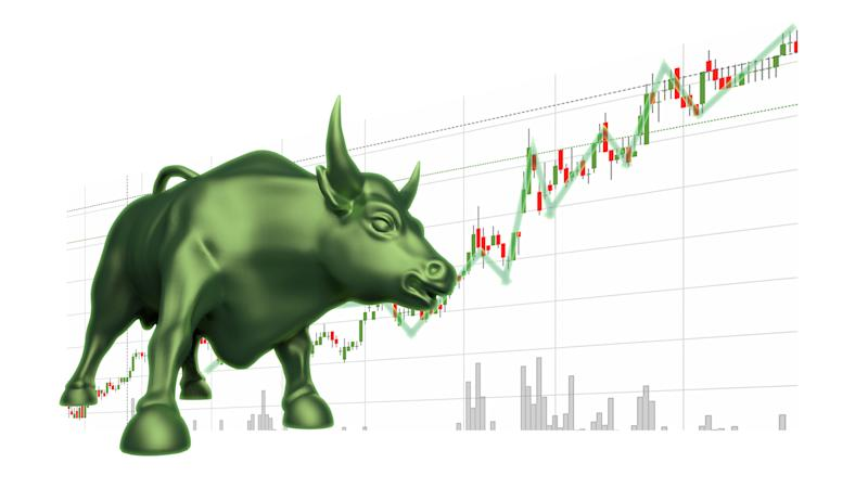 A bull in front of a stock chart
