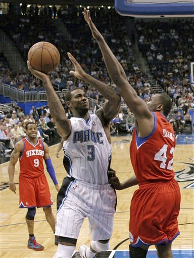 Orlando Magic's Earl Clark (3) takes a shot over Philadelphia 76ers' Elton Brand (42) during the first half of an NBA basketball game, Monday, April 16, 2012, in Orlando, Fla. (AP Photo/John Raoux)