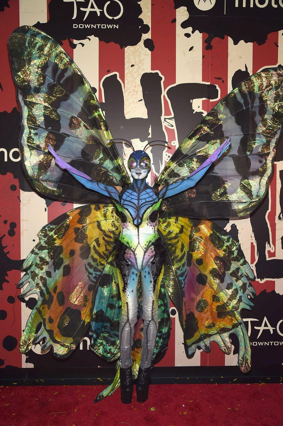 <p>Um, did we just take a trip to Cirque de Soleil?! Heidi waltzed through the streets of New York City in this bold and beautiful butterfly costume, massive wingspan included. </p>