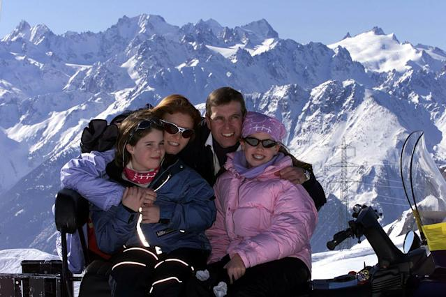 Prince Andrew, pictured here in 2001 with the Duchess York and daughters Princess Eugenie and Princess Beatrice during a skiing holiday in the Swiss Alps, is embroiled in a legal battle over claims he has not paid a bill for his Swiss chalet. (Picture: PA)