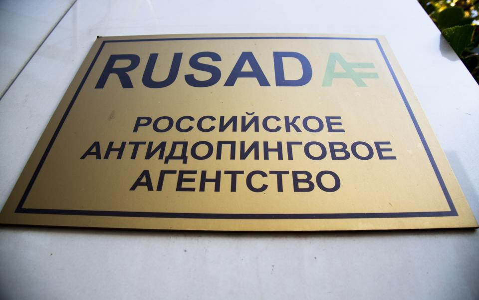 """A sign reading """"Russian National Anti-doping Agency RUSADA"""" on a building in Moscow, Russia, Thursday, Sept. 20, 2018. The World Anti-Doping Agency has reinstated Russia, ending a nearly three-year suspension caused by state-sponsored doping. (AP Photo/Alexander Zemlianichenko)"""