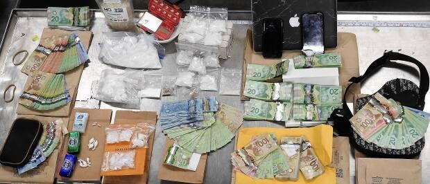 Edmonton police seized 571.5 grams of meth, 168.5 grams of cocaine and nearly $40,000 on Friday after a month-long investigation. (Submitted by Edmonton Police Service - image credit)