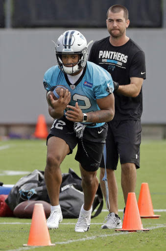 Carolina Panthers' D.J. Moore (12) runs a drill during practice at the NFL football team's facility in Charlotte, N.C., Tuesday, May 22, 2018. While NFL owners are voting to approve the new Panthers owner in Atlanta, the team David Tepper is about to officially own takes to the field for the OTAs back in Charlotte with plenty of new faces. (AP Photo/Chuck Burton)