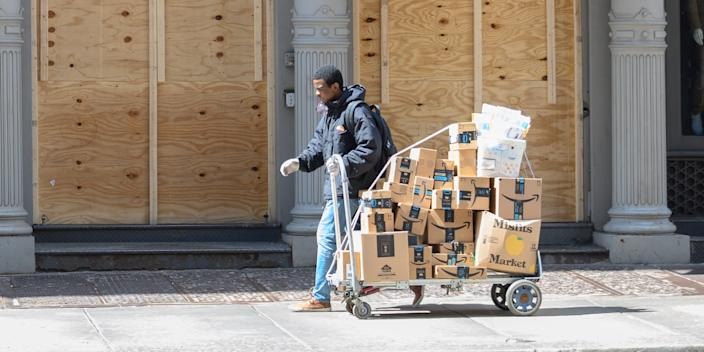 An Amazon courier outside a store in Broadway, New York City, on April 15, 2020.