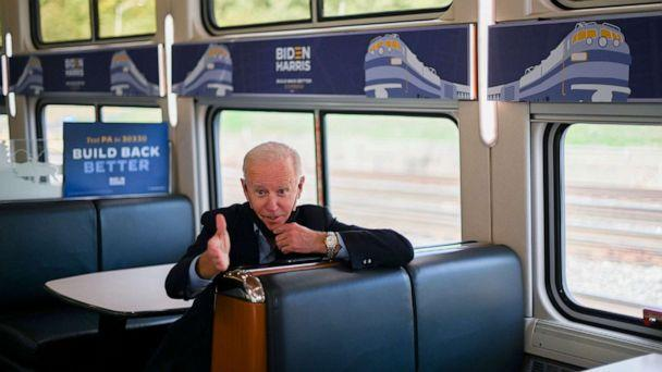 PHOTO: Democratic presidential nominee and former Vice President Joe Biden speaks to teacher Denny Flora (not shown) as they ride a train to Pittsburgh, Pennsylvania, Sept. 30, 2020. (Roberto Schmidt/AFP via Getty Images, FILE)