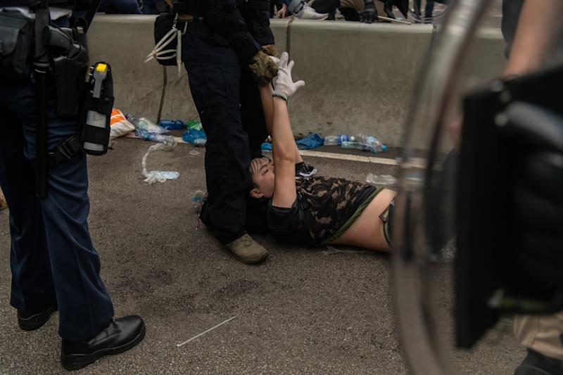 HONG KONG, HONG KONG - JUNE 12: A protester is arrested during a protest against a proposed extradition law on June 12, 2019 in Hong Kong, Hong Kong. Large crowds of protesters gathered in central Hong Kong as the city braced for another mass rally in a show of strength against the government over a divisive plan to allow extraditions to China. (Photo by Billy H.C. Kwok/Getty Images)