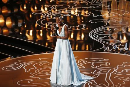 """Nyong'o, best supporting actress winner for her role in """"12 Years a Slave"""", racts on stage at the 86th Academy Awards in Hollywood"""