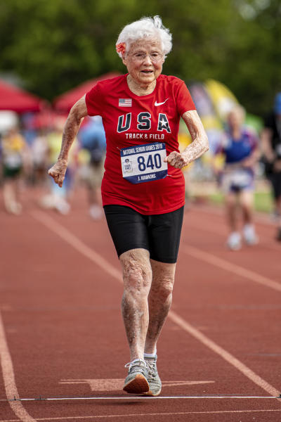 In this photo provided by the National Senior Games Association, 103-year-old Julia Hawkins, of Baton Rouge, La., competes in the 50-meter event at the 2019 National Senior Games in Albuquerque, N.M., Monday, June 17, 2019. (Brit Huckabay/NSGA via AP)