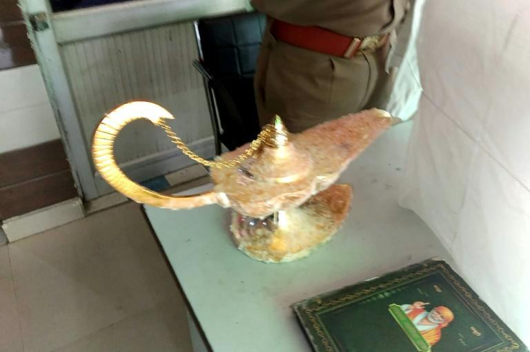 A handout photograph released by the Uttar Pradesh Police shows the lamp allegedly sold for $93,000