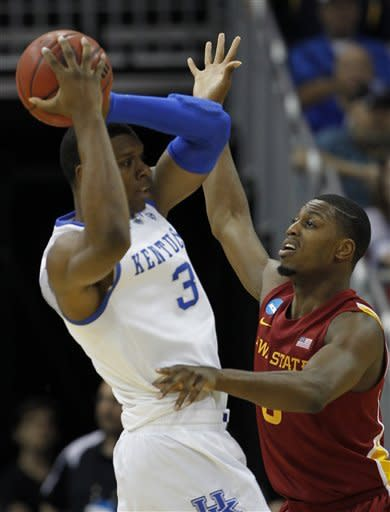 Kentucky forward Terrence Jones (3) is guarded by Iowa State forward Melvin Ejim, right, in the first half of their NCAA third-round tournament college basketball game in Louisville, Ky., Saturday, March 17, 2012. (AP Photo/John Bazemore)