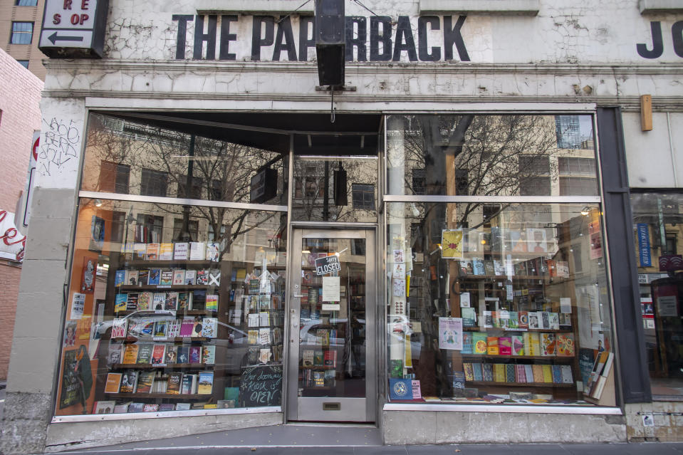 The Paperback bookstore sits closed during lockdown due to the continuing spread of the coronavirus in Melbourne, Thursday, Aug. 6, 2020. Victoria state, Australia's coronavirus hot spot, announced on Monday that businesses will be closed and scaled down in a bid to curb the spread of the virus. (AP Photo/Andy Brownbill)