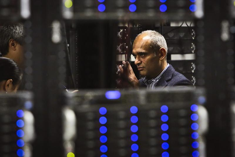 In this Thursday, Dec. 20, 2012, photo, Chet Kanojia, founder and CEO of Aereo, Inc., gives a tour of the company's technology floor in New York. Aereo is one of several startups created to deliver traditional media over the Internet without licensing agreements. Past efforts have typically been rejected by courts as copyright violations. In Aereo's case, the judge accepted the company's legal reasoning, but with reluctance. (AP Photo/Bebeto Matthews)
