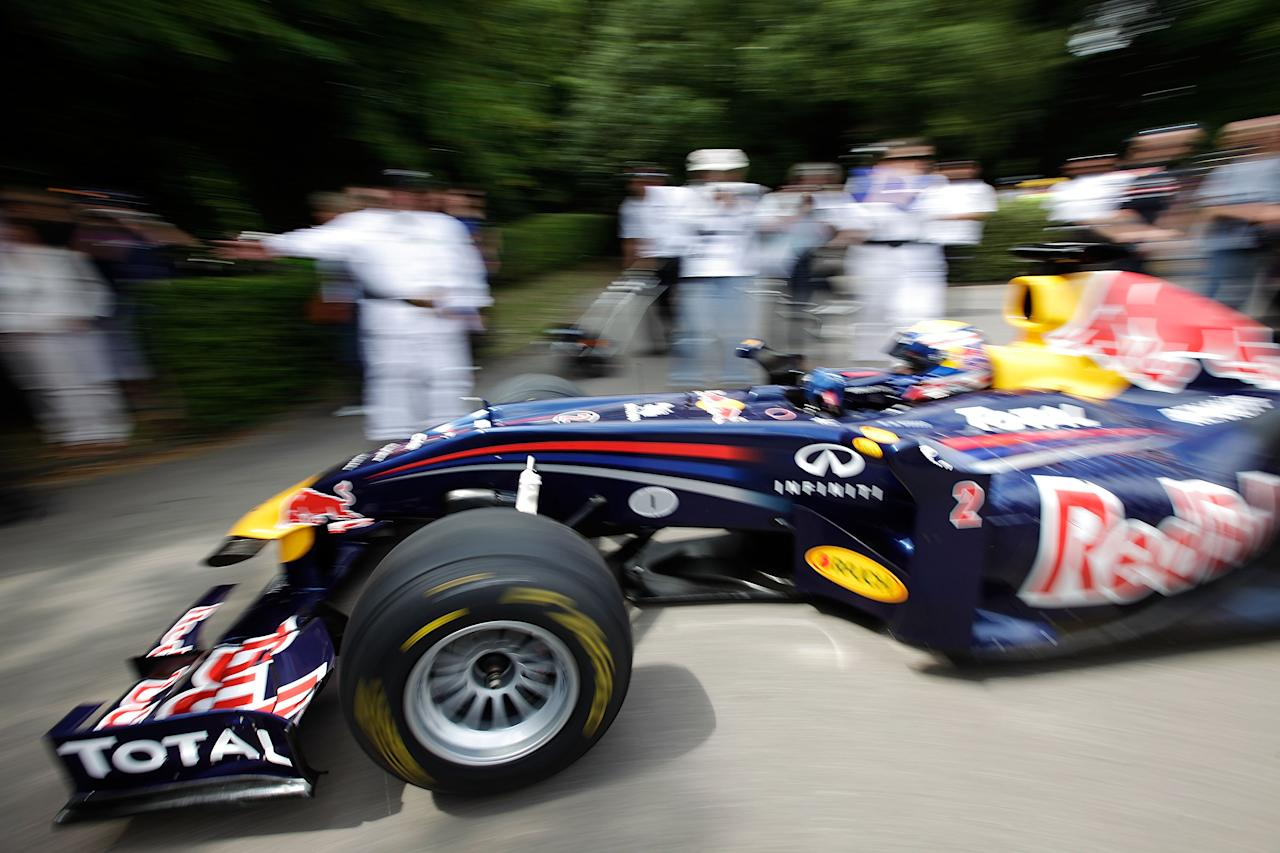 CHICHESTER, ENGLAND - JULY 01:  Red Bull Racing driver Mark Webber's car is prepared in the assembly area prior to a run at the Goodwood Festival of Speed on July 1, 2011 in Chichester, England. Drivers compete in a variety of cars, from vintage models to modern Formula 1 cars in the annual hill climb.  (Photo by Matthew Lloyd/Getty Images)