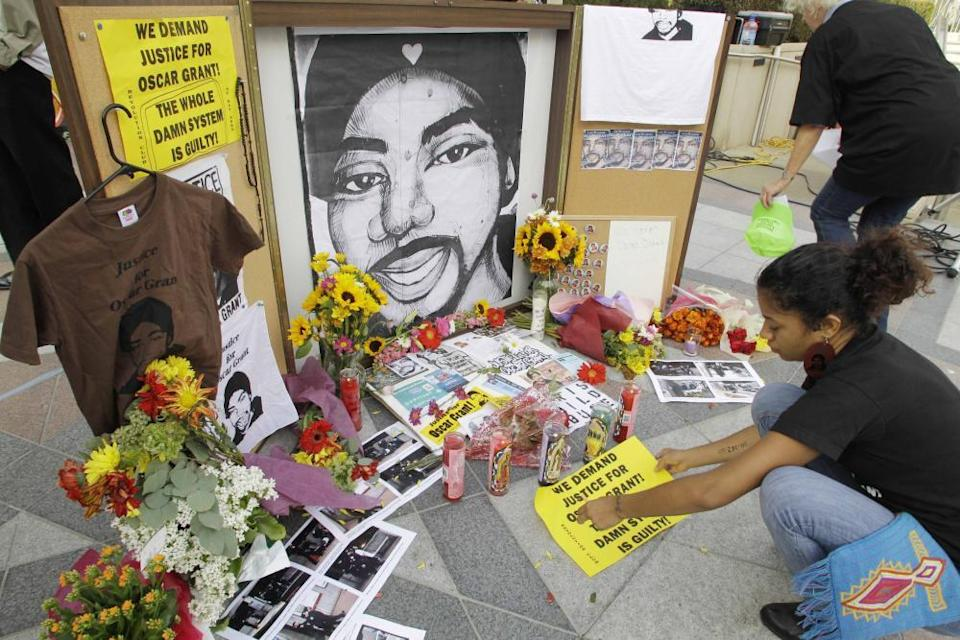 People leaves messages at a memorial to Oscar Grant in Oakland, California on 5 October 2010.