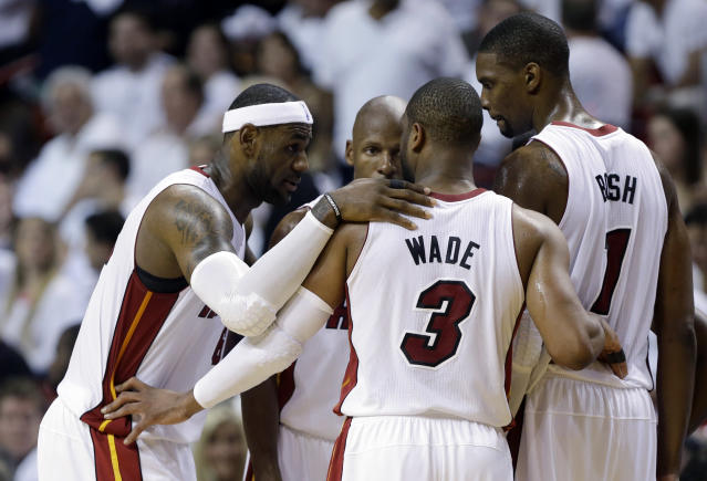 Miami Heat's LeBron James, left, Dwyane Wade (3), Chris Bosh (1) and Ray Allen, center, huddle on the court in the second half of Game 1 in an NBA basketball Eastern Conference semifinal playoff series against the Brooklyn Nets, Tuesday, May 6, 2014, in Miami. The Heat defeated the Nets 107-86. (AP Photo/Lynne Sladky)
