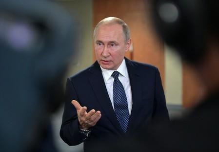 Russia's President Putin meets with journalists in Yekaterinburg