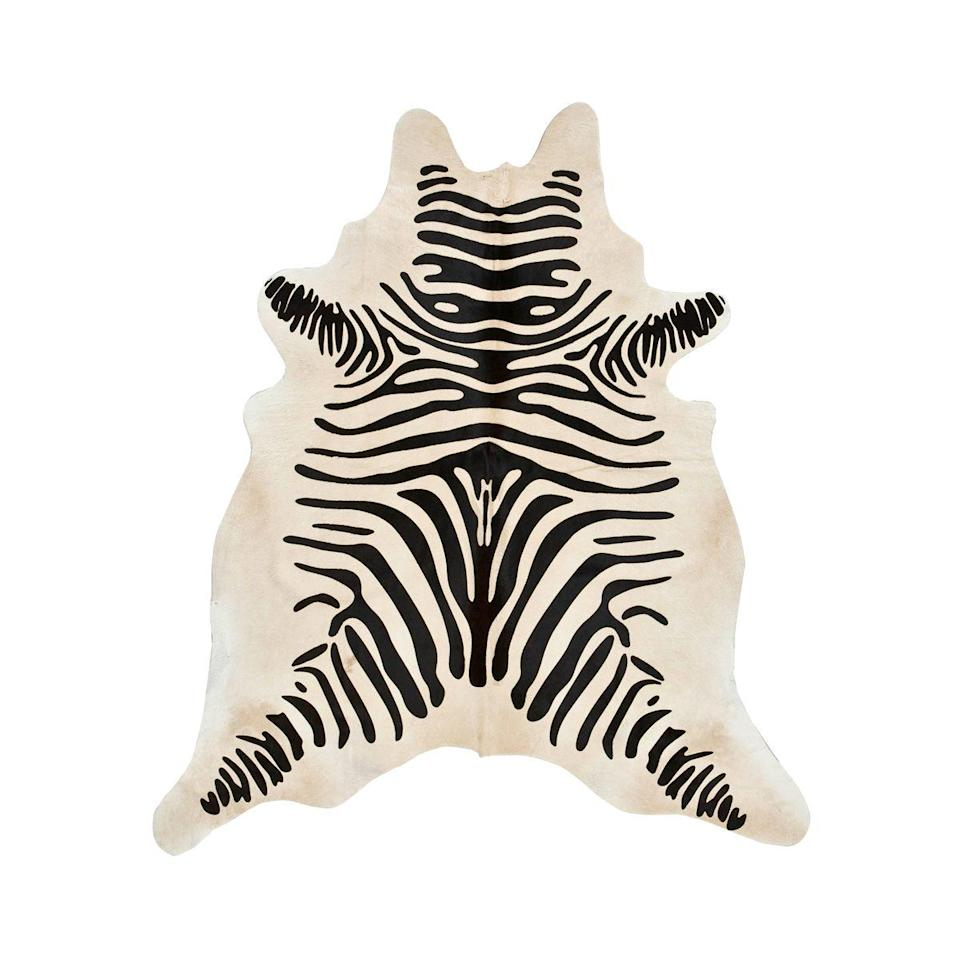 "<p><strong>Zebra</strong></p><p>lonestarwesterndecor.com</p><p><strong>$279.95</strong></p><p><a href=""https://www.lonestarwesterndecor.com/zebra-stenciled-black-on-light-beige-cowhide-rug.html"" rel=""nofollow noopener"" target=""_blank"" data-ylk=""slk:Shop Now"" class=""link rapid-noclick-resp"">Shop Now</a></p><p>This natural cowhide has a zebra patterned stenciled over it, giving you that ranch-meets-grasslands vibe. It's a fun twist that guests will definitely notice and remember. </p>"
