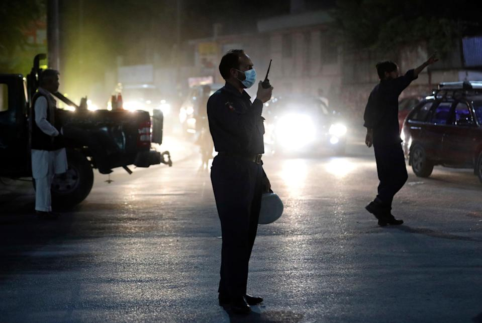 Afghan security personnel work at the site of Tuesday's powerful explosion in Kabul (AP)