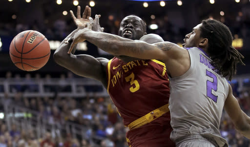Kansas State's Cartier Diarra (2) knocks the ball away from Iowa State's Marial Shayok (3) during the first half of an NCAA college basketball game in the Big 12 men's tournament Friday, March 15, 2019, in Kansas City, Mo. (AP Photo/Charlie Riedel)
