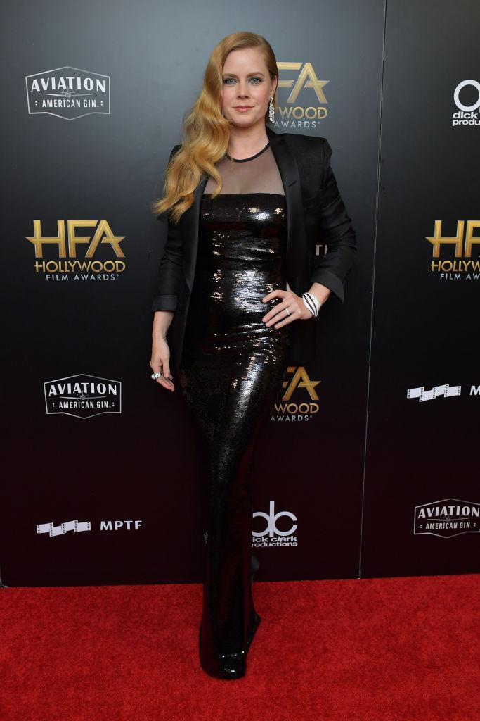 <p>Adams went with the same sheer and sequin combo as Janney, wearing a dress of the two materials with a blazer over top. (Photo: Getty Images) </p>
