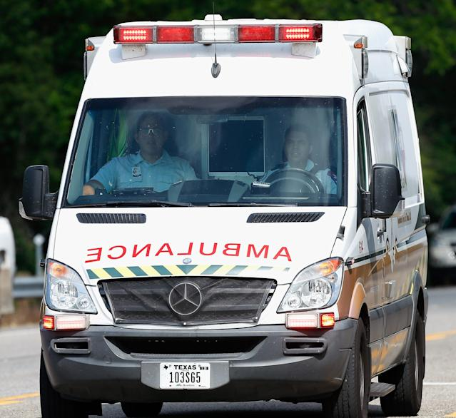<p>Emergency medical personnel arrive on location at Santa Fe High School where a shooting took place on May 18, 2018 in Santa Fe, Texas. (Photo: Bob Levey/Getty Images) </p>