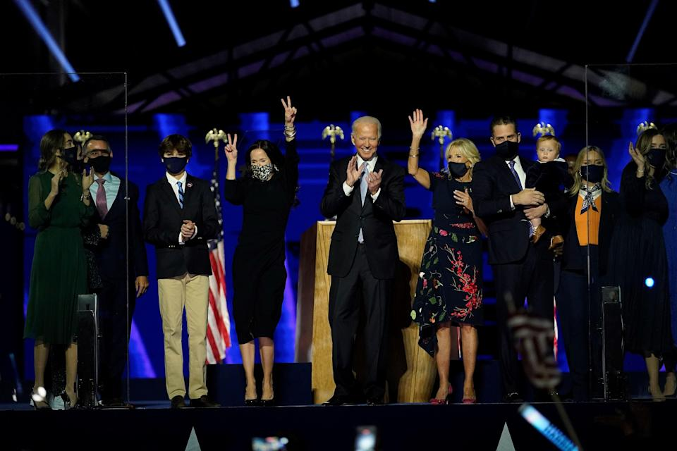President-elect Joe Biden, cente, with his wife Jill Biden and members of this family  salute the crowd on stage after delivering remarks in Wilmington, Delaware, on November 7, 2020.