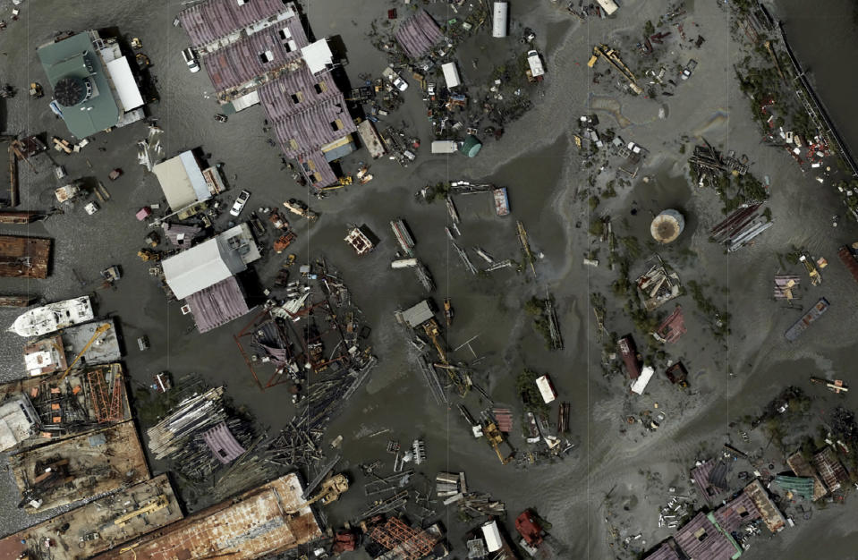 In this drone image released by NOAA, flood waters cover Tom's Marine & Salvage in Barataria, La., following the aftermath of Hurricane Ida. (NOAA via AP)
