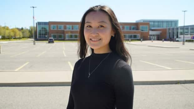 The pandemic hit right in the middle of Charis Liu's Grade 11 year at Markham District High School. That means she and her cohort have only had two-and-a-half years of 'normal' high school.  (Keith Burgess/CBC News  - image credit)